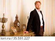 Portrait of confident rich man from royal family posing in expensive... Стоковое фото, фотограф Zoonar.com/Svyatoslav Lypynskyy / easy Fotostock / Фотобанк Лори