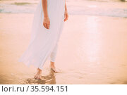 Goa, India. Close Legs And Hands Of Young Woman In White Dress Near... Стоковое фото, фотограф Ryhor Bruyeu / easy Fotostock / Фотобанк Лори