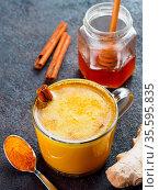 Healthy drink golden turmeric latte in glass cup.Gold milk with turmeric... Стоковое фото, фотограф Zoonar.com/Olga Sergeeva / easy Fotostock / Фотобанк Лори