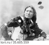 Native North American Indian warrior.   Photograph by Edward Curtis... Редакционное фото, агентство World History Archive / Фотобанк Лори