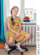 portrait of a girl with a beautiful braid sitting on a chair. Стоковое фото, фотограф Акиньшин Владимир / Фотобанк Лори