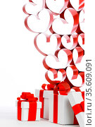 White boxes with red ribbons and decorative hearts isolated on white... Стоковое фото, фотограф Zoonar.com/Ivan Mikhaylov / easy Fotostock / Фотобанк Лори