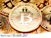 Background of gold coins with bitcoin sign. Стоковое фото, фотограф Zoonar.com/Ivan Mikhaylov / easy Fotostock / Фотобанк Лори