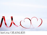 Red heart shaped ribbon on white fur background Valentines day design... Стоковое фото, фотограф Zoonar.com/Ivan Mikhaylov / easy Fotostock / Фотобанк Лори
