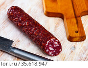 Tasty dried semi-dry sausage Braunschweig with rosemary. Стоковое фото, фотограф Яков Филимонов / Фотобанк Лори