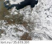Snow over Poland and its neighbours. True-color Aqua MODIS image ... (2003 год). Редакционное фото, агентство World History Archive / Фотобанк Лори