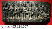 Planetary gods shown on an Indian stone relief, circa 1000-1200. ... Редакционное фото, агентство World History Archive / Фотобанк Лори