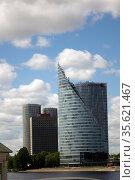 RIGA, LATVIA - MAY 27, 2016: new high-rise buildings on the banks of the Daugava. Стоковое фото, фотограф Куликов Константин / Фотобанк Лори