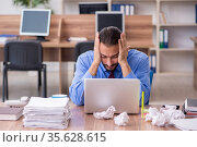Young male employee in brainstorming concept. Стоковое фото, фотограф Elnur / Фотобанк Лори