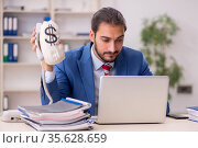 Young male employee in remuneration concept. Стоковое фото, фотограф Elnur / Фотобанк Лори