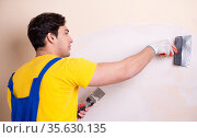 Young contractor employee applying plaster on wall. Стоковое фото, фотограф Elnur / Фотобанк Лори