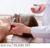 Young woman in spa health concept with face mask. Стоковое фото, фотограф Elnur / Фотобанк Лори