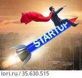 Superhero businessman in start-up concept flying rocket. Стоковое фото, фотограф Elnur / Фотобанк Лори