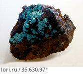 Turquoise.  Blue-green small spheres with hisingerite.  West Phoenix... Редакционное фото, агентство World History Archive / Фотобанк Лори