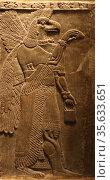 Assyrian gateways. Relief of protective Eagle-headed spirit. circa... (2009 год). Редакционное фото, агентство World History Archive / Фотобанк Лори