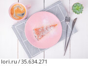 Piece of pie on a pink plate with a knife and a fork on linen napkin. Стоковое фото, фотограф Ольга Губская / Фотобанк Лори