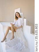 Beautiful caucasian woman with angel wings poses in the studio. Стоковое фото, фотограф Алексей Кузнецов / Фотобанк Лори