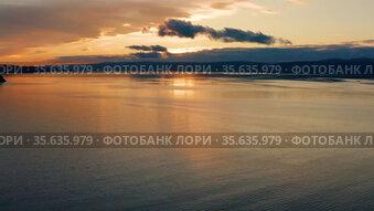 Озеро Байкал осенью. Пролив Малое море. Вид с воздуха. Lake Baikal in autumn. Olkhon Island. Small Sea strait. Aerial view.