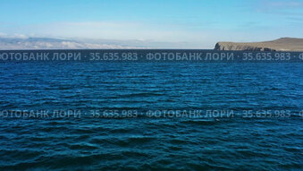 Озеро Байкал осенью. Пролив Малое море. Вид с воздуха. Lake Baikal in autumn. Small Sea strait. Aerial view.