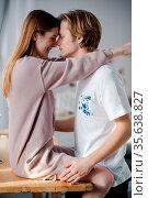 A portrait of two stylish loving people. A girls is sitting on a big... Стоковое фото, фотограф Zoonar.com/Svyatoslav Lypynskyy / easy Fotostock / Фотобанк Лори