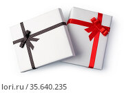 White present paper boxes with ribbon bow, isolated on white. Стоковое фото, фотограф Zoonar.com/Serghei Platonov / easy Fotostock / Фотобанк Лори
