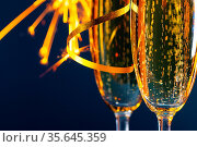 Two glasses of champagne and sparklers lights in the background New... Стоковое фото, фотограф Zoonar.com/Ivan Mikhaylov / easy Fotostock / Фотобанк Лори