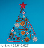 Christmas Tree made of decor on blue paper background. Christmas Holiday... Стоковое фото, фотограф Zoonar.com/Ivan Mikhaylov / easy Fotostock / Фотобанк Лори