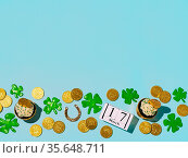St Patrick's Day concept with copy space. Modern still life with lucky... Стоковое фото, фотограф Zoonar.com/Olga Sergeeva / easy Fotostock / Фотобанк Лори