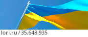 3D rendering of the national flag of Ukraine waving in the wind against... Стоковое фото, фотограф Zoonar.com/Aleksey Butenkov / easy Fotostock / Фотобанк Лори