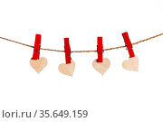 Clothes pegs and red paper hearts on rope isolated on white background. Стоковое фото, фотограф Zoonar.com/Ivan Mikhaylov / easy Fotostock / Фотобанк Лори