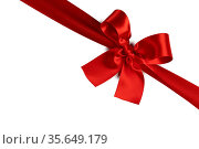 Red gift bow isolated on white background holiday gift concept. Стоковое фото, фотограф Zoonar.com/Ivan Mikhaylov / easy Fotostock / Фотобанк Лори