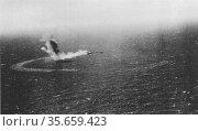 The United States Navy fleet oiler Neosho is left burning and slowly... Редакционное фото, агентство World History Archive / Фотобанк Лори