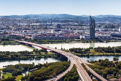 Top view of Vienna, the road bridge over the Danube, the road junction and the Millennium skyscraper. Vienna, Austria