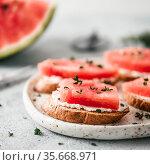 Toasts with watermelon, soft cheese and thyme. Стоковое фото, фотограф Ольга Сергеева / Фотобанк Лори