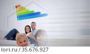 Composition of family and energy efficiency rating with screen of smoke. Стоковое фото, агентство Wavebreak Media / Фотобанк Лори
