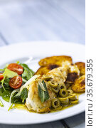Chicken breast baked on sage with green olive sauce with salad and... Стоковое фото, фотограф Richard Semik / easy Fotostock / Фотобанк Лори