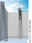 Businessman climbing a ladder to escape from problems. Стоковое фото, фотограф Elnur / Фотобанк Лори