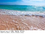 Sand beach and blue sea surf waves close up. Стоковое фото, фотограф Zoonar.com/Ivan Mikhaylov / easy Fotostock / Фотобанк Лори