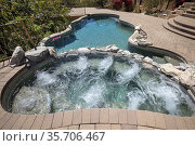 Hot tub with swimming pool and terraced patio at a luxury home in... Стоковое фото, фотограф Larry Malvin / age Fotostock / Фотобанк Лори
