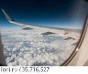 Airplane wing. view from the airplanes porthole. Стоковое фото, фотограф Яков Филимонов / Фотобанк Лори
