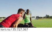 Diverse fit men cross training outdoors with tire. Стоковое видео, агентство Wavebreak Media / Фотобанк Лори