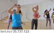 Group of smiling women training sport dance in modern studio. Стоковое видео, видеограф Яков Филимонов / Фотобанк Лори