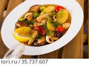 Mushroom broth prepared with boiled honey fungus and vegetables. Стоковое фото, фотограф Яков Филимонов / Фотобанк Лори
