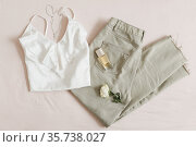 Top view of women casual day outfit, stylish clothes and accessories on beige background. Flat lay. Стоковое фото, фотограф Galina kondratenko / Фотобанк Лори