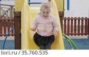 Activities and fun on outdoor playground. Стоковое видео, видеограф Данил Руденко / Фотобанк Лори
