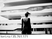 Fashion model against Zaha Hadid Dominion Tower exterior, Moscow, ... Стоковое фото, фотограф Zoonar.com/Max / age Fotostock / Фотобанк Лори