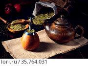 Prepare yerba mate with calabash and bombilla. Стоковое фото, фотограф Zoonar.com/Darius Dzinnik / easy Fotostock / Фотобанк Лори