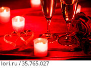Valentines day background with champagne glasses candles and hearts. Стоковое фото, фотограф Zoonar.com/Ivan Mikhaylov / easy Fotostock / Фотобанк Лори
