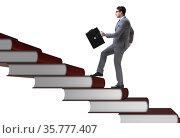 Businessman student climbing the ladder of education books. Стоковое фото, фотограф Elnur / Фотобанк Лори