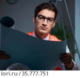 Construction architect working on drawings late at night. Стоковое фото, фотограф Elnur / Фотобанк Лори